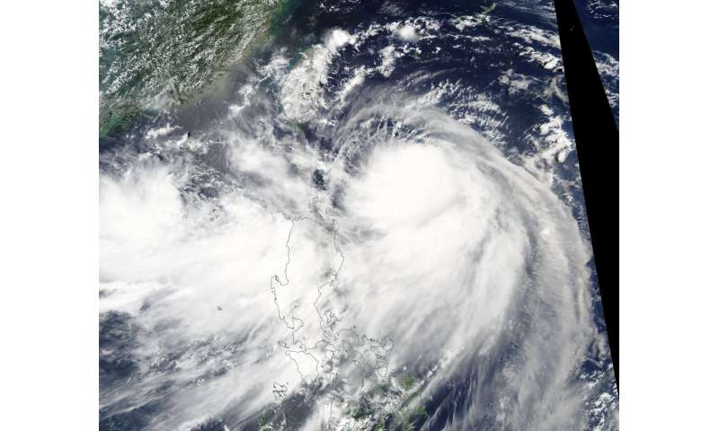 NASA's Aqua satellite tracks Typhoon Nesat headed toward Taiwan