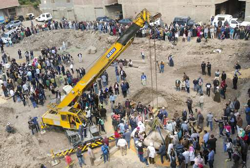 Second part of ancient Egyptian statue lifted from site