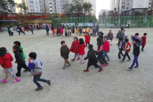 South Korean children heading to a shelter after the 5.4-magnitude earthquake struck