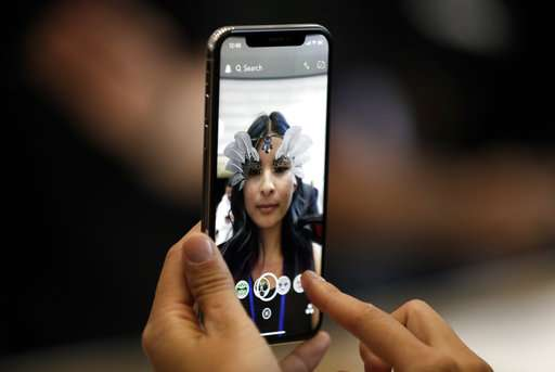 The Latest: Analysts notes potential for iPhone X features