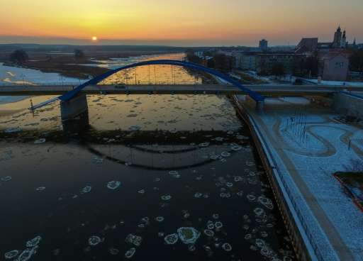 "Aerial view shows round pieces of ice, so-called ""Pfannkucheneis"" (pancake ice), floating on the river Oder between no"