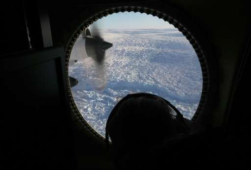 A glacier is seen from NASA's Operation IceBridge research aircraft  above Greenland, studying how polar ice has evolved over th