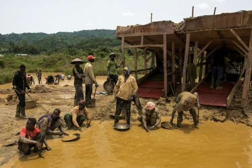 A group of galamseyers, illegal gold panners, working in the Kibi area of Ghana, long known for its bountiful gold reserves.