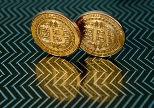 """A key US regulator gave the green light for trading in bitcoin futures on two major exchanges, but warned """"of the potential"""