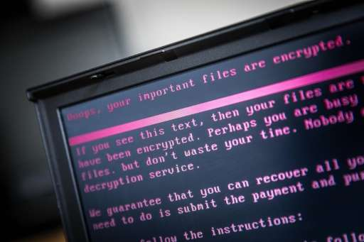 A laptop displays a message demanding payment for unlocking files encrypted by the ransomware attack that spread from Ukraine an