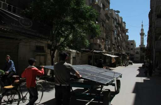 A mobile solar generator, here seen on June 7, 2017, is providing power to schools and mosques in Syria's rebel-held town of Dou