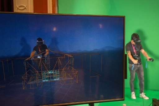 A monitor reveals the virtual reality experience of a man using the HTC Vive during the 2017 Consumer Electronic Show in Las Veg