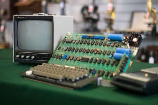 An antique Apple Computer 1 from 1976, one of just eight still working, fetched 110,000 euros at auction in Germany, below a for
