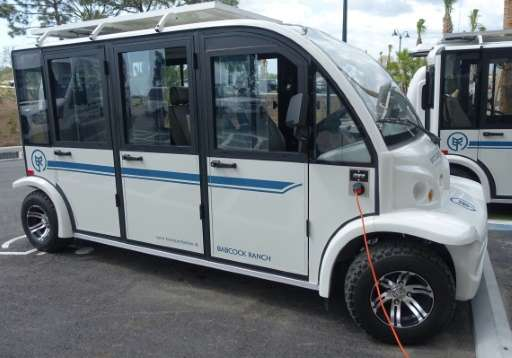 An electric shuttle gets a charge at Babcock Ranch, Florida's first sustainable town with farm-to-table restaurant, homes with t