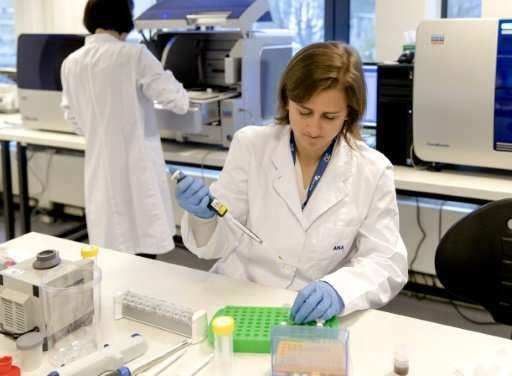 An employee works at the new state-of the-art DNA laboratory of the International Commission on Missing Persons, in The Hague, o