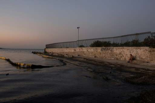 An oily sea on a beach near Athens, five days after the sinking of a tanker, has triggered criticism from environmental groups o