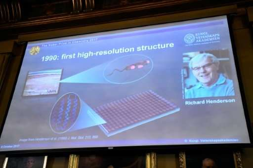 A picture of Richard Henderson shown at the Nobel announcement on a screen displaying details of his work