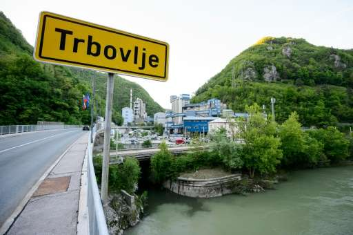 A picture shows a road sign indicating the entrance to the central Slovenian town of Trbovlje, with the Lafarge cement factory i