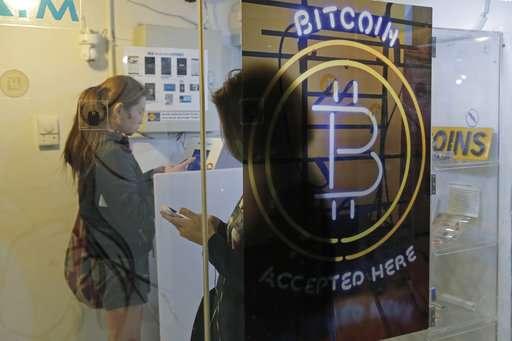 As Bitcoin, other currencies soar, regulators urge caution