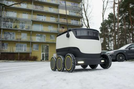 A six-wheeled robot by Starship Technologies makes its way to deliver food from a restaurant in Tallinn, Estonia