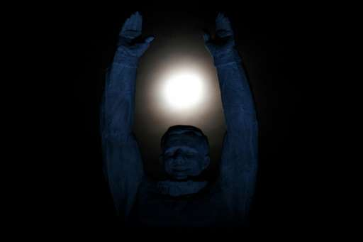 A statue of the first man in space, Russia's Yuri Gagarin, reaching for the moon