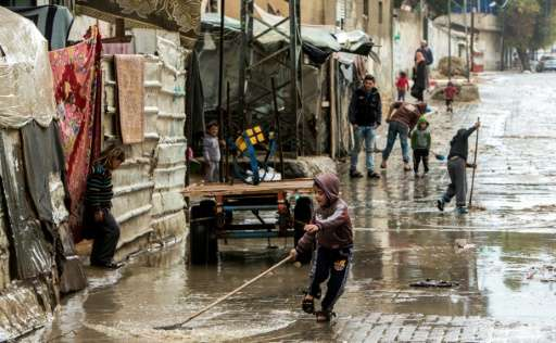 A street after rainfall in Beit Lahia, Gaza, where radical changes in behaviour are needed to improve water quality, including s
