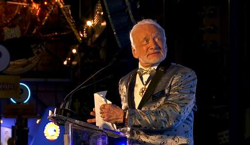 Astronaut Buzz Aldrin rolls out the red carpet for Mars