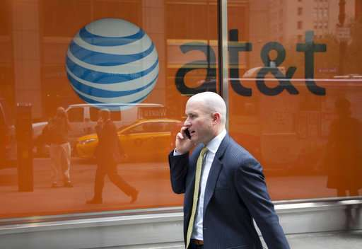 AT&T tops Wall Street's profit, revenue forecasts