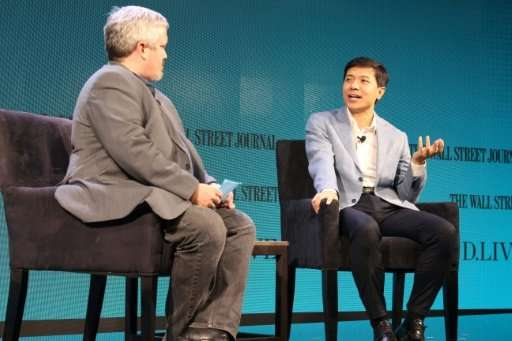 Baidu chief executive Robin Li (R) says his company is working with a large bus maker in China to have a self-driving bus runnin