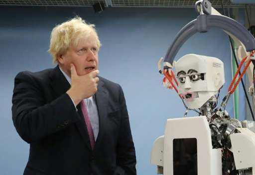 Britain's Foreign Secretary Boris Johnson visits the robotic centre at Waseda University, which works closely with Britain's Uni