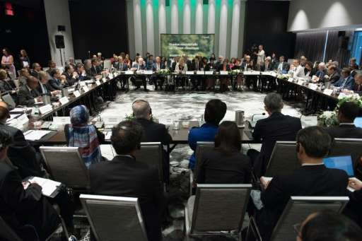 Canada co-hosts an environment ministerial meeting with China and the European union to move forward on the Paris agreement and