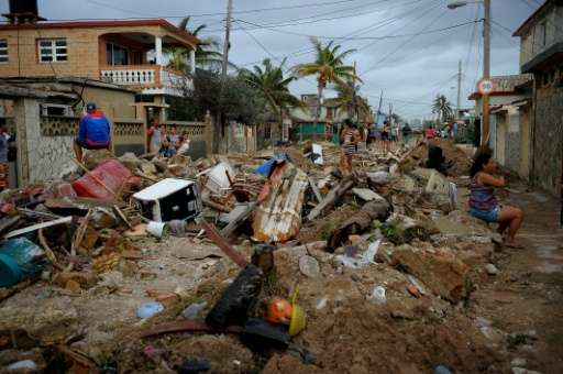 Debris lies piled in the streets of Cojimar in Havana after the passing of  Hurricane Irma on September 10, 2017