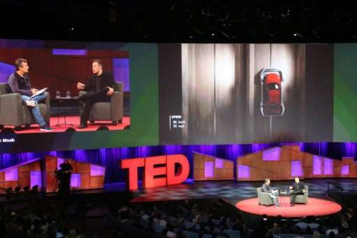Elon Musk went teased the audience with a photo of a self-driving truck that his company Tesla Motors is adding to its line of e