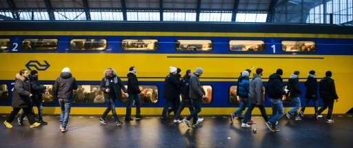"Eneco and NS said on a joint website that some 600,000 passengers daily are ""the first in the world"" to travel thanks"