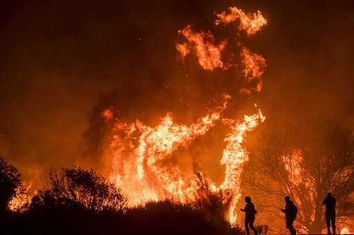 Forecast of higher winds could complicate wildfire fight