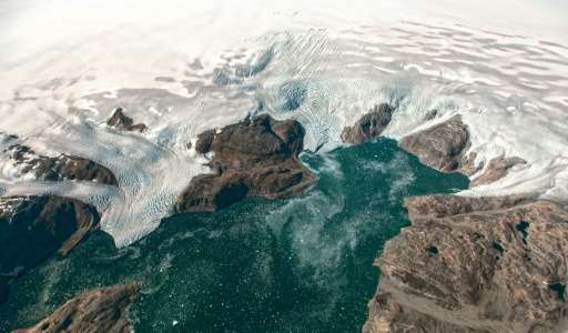 Greenland contains enough frozen water to lift oceans by about seven metres (23 feet), though experts disagree on the global war