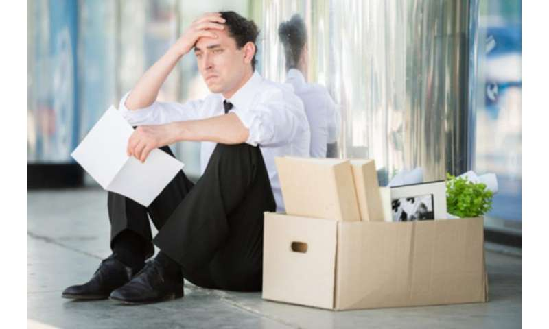 How can job loss be bad for health, and recession be good for it?