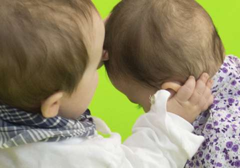 How do babies coordinate gestures and vocalization?