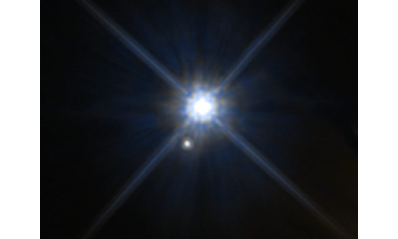 Hubble astronomers use a century-old relativity experiment to measure a white dwarf's mass