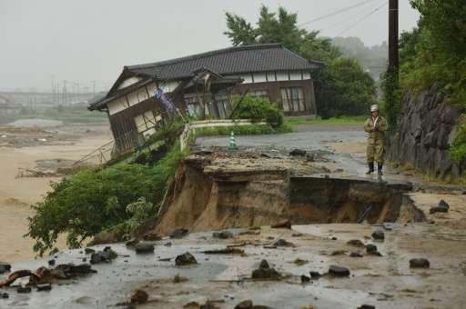 Huge floods engulfing parts of southern Japan have left hundreds stranded