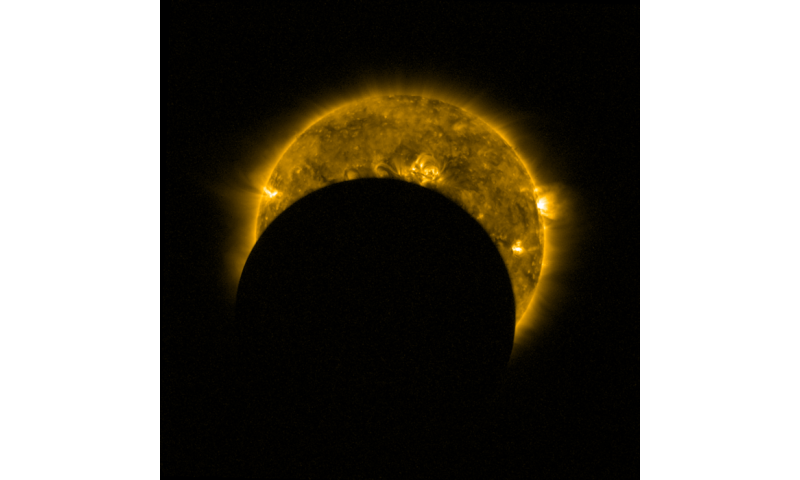 image a partial solar eclipse seen from space