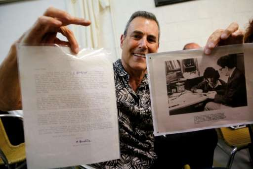 Israeli illusionist and magician Uri Geller shows a letter from Nobel Prize-winning physicist Albert Einstein he bought at a Jer