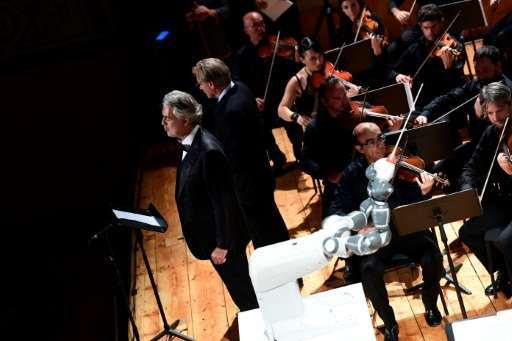 Italian tenor Andrea Bocelli performing alongside YuMi, which conducted three pieces of music