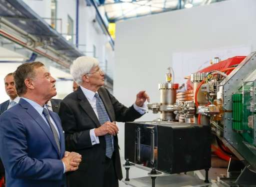 Jordan's King Abdullah II (L) attends the launch of The International Centre for Synchrotron-Light for Experimental Science and
