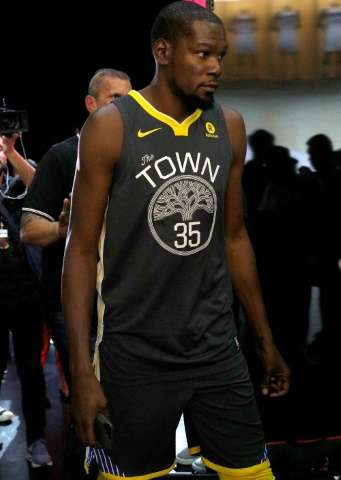 Kevin Durant of the Golden State Warriors debuts the new jersey during the unveiling of the New NBA Partnership with Nike, in Lo