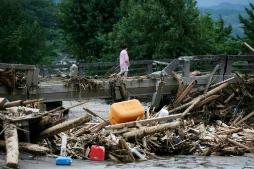 Kyushu has been left devastated after overflowing rivers and torrential downpours swept away roads, houses and schools