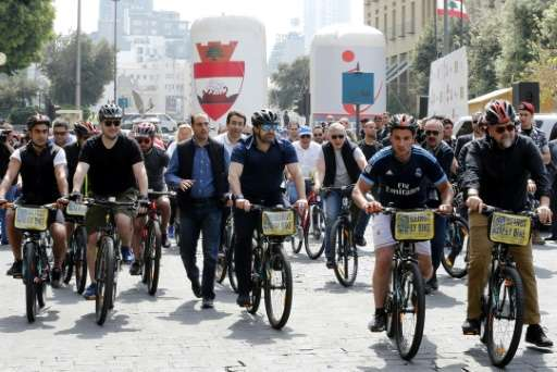 Lebanese Prime Minister Saad Hariri (C) rides a bike at an event to launch a public bicycle-sharing system in Beirut on April 30