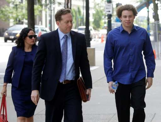 Marcus Hutchins (R), the British cyber security expert accused of creating and selling malware that steals banking passwords, ap
