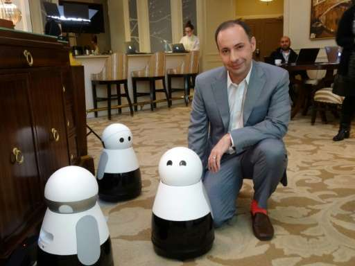 Mayfield Robotics chief executive Michael Beebe unveils the Kuri robot at the Consumer Electronics Show in Las Vegas, on January