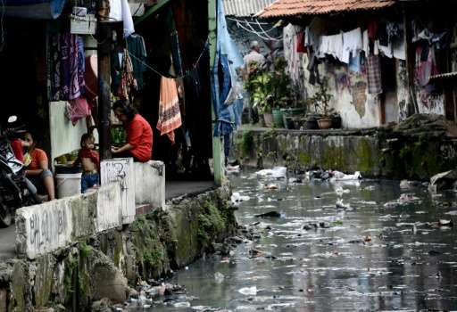 Narrow ducts that run from Jakarta's main waterways and through slums are often filled with rubbish due to the lack of a decent