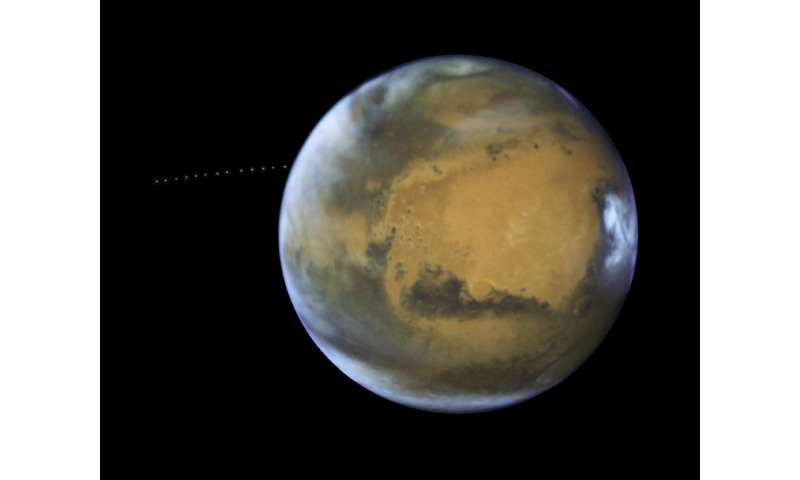 NASA's Hubble sees martian moon orbiting the Red Planet
