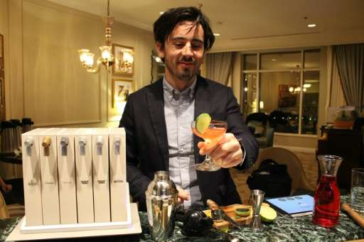 "Opn manager Tristan Capelier demonstrates the Pernot Ricard-backed home ""mixology"" unit at the Consumer Electronics Sh"