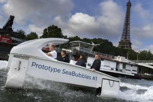 Paris Mayor Anne Hidalgo took a spin on the Seine for a test ride of the electric Sea Bubble water taxi