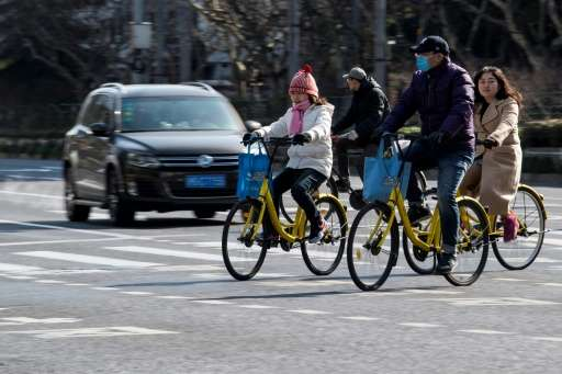 People ride Ofo-bicycles in Shanghai