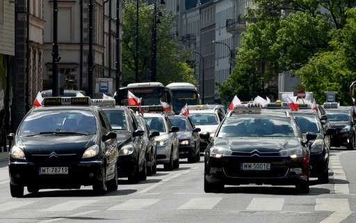 Polish taxi drivers blocked the streets of Warsaw to protest against ride sharing app Uber and competitors, arguing they represe